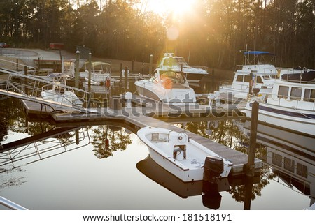 Marina port with  luxury yachts at sunrise. Beautiful view of boats at sunset - stock photo