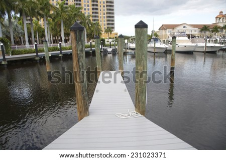 Marina resort in Cape Coral, wooden path, Florida - stock photo