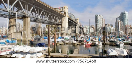 Marina Under the Burrad Bridge in Granville Island in Vancouver BC Canada - stock photo