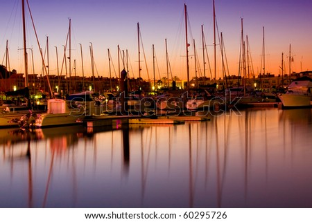 Marina with docked yachts at the end of the day - stock photo