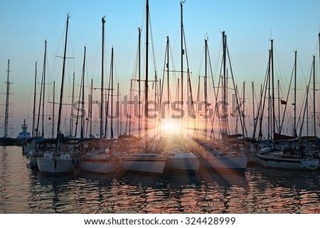 Marina with docked yachts at the end of the day, kusadasi Turkey - stock photo