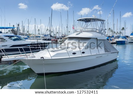 Marina with luxury yachts and white boats - stock photo