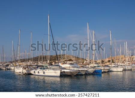 Marina yachts and ancient fortress on background in Cesme, Turkey
