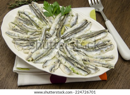 Marinated anchovies in vinegar and olive oil - stock photo