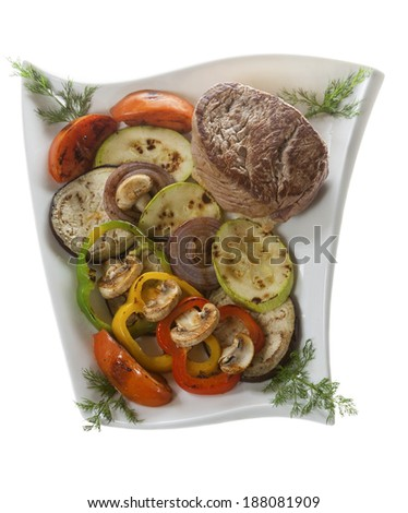 Marinated beefsteak  and grilled vegetables on a plate - stock photo