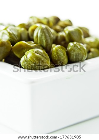 Marinated capers isolated on a white background - stock photo