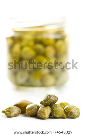 marinated capers on white background - stock photo