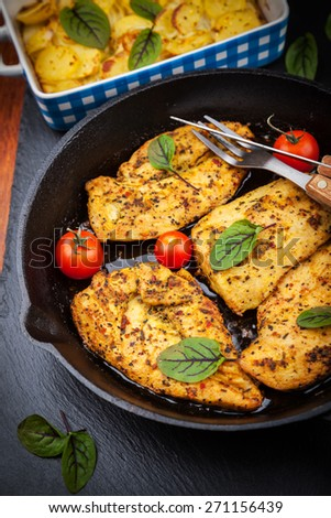 Marinated chicken breast with potato gratin - stock photo