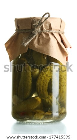 Marinated cucumbers in a glass jar isolated on white - stock photo