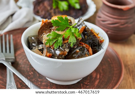 Marinated eggplant with onion and carrot.