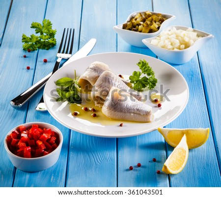 Marinated herring fillets - stock photo