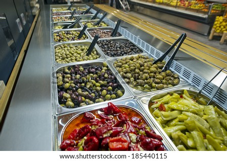 marinated olives for sale at the market - stock photo