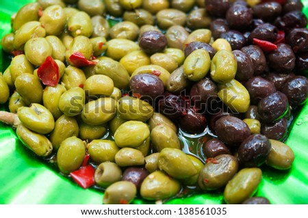 marinated olives, green and black,mediterranean food - stock photo