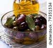 Marinated olives in a glass bowl - stock photo