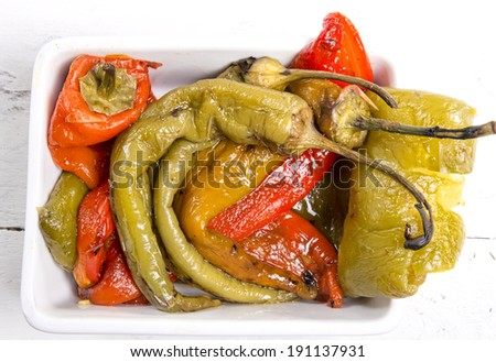 marinated peppers in a small colorful bowl - stock photo