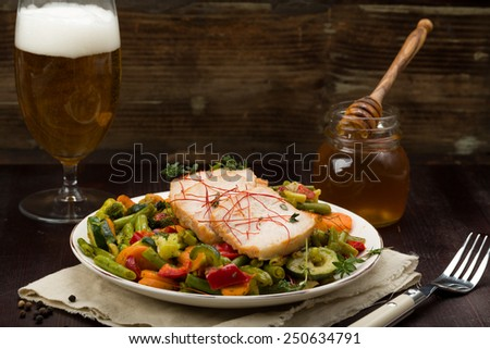 Marinated pork with vegetables, fresh herbs and honey