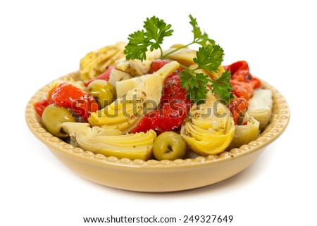 Marinated Roasted Red Peppers, Artichokes, Olives and Basil Dressing on white background. Selective focus. - stock photo