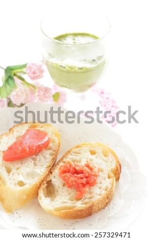 marinated roe of pollock, Japanese food  Mentaiko on bread served with green tea Latte - stock photo