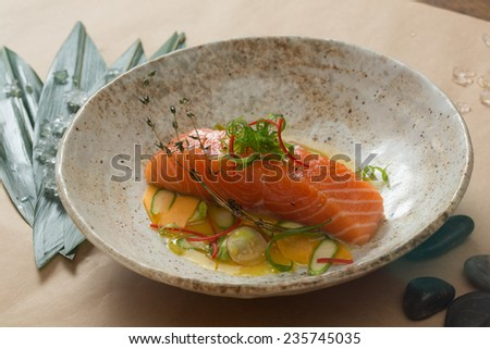 Marinated salmon with green salad and spices.  Shallow dof.  - stock photo