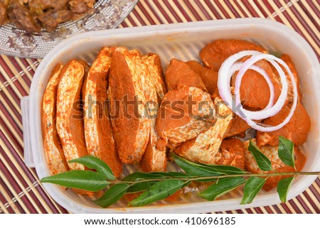Marinated Seer fish / King fish ready for cooking - Kerala Cuisine. Masala Fish Fry / curry from Kerala, India. Food for Ramadan, Ramzan, Eid Christmas, Easter, Onam - stock photo