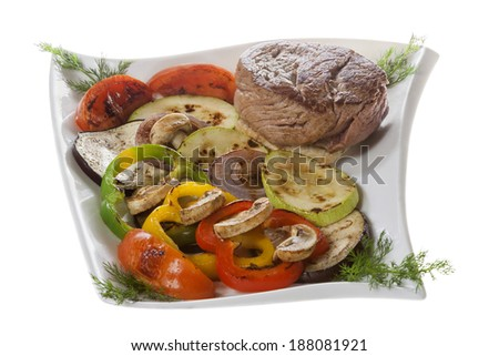 Marinated steak and grilled vegetables on a plate. - stock photo