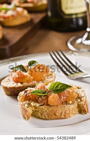 Marinated Tomato Bruschetta with Basil and Grated Cheese. Studio Photography. - stock photo