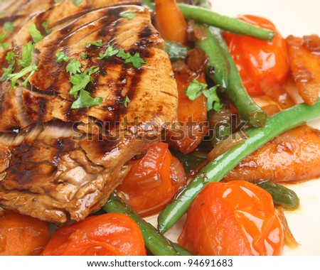 Marinated tuna steak with stir-fried vegetables