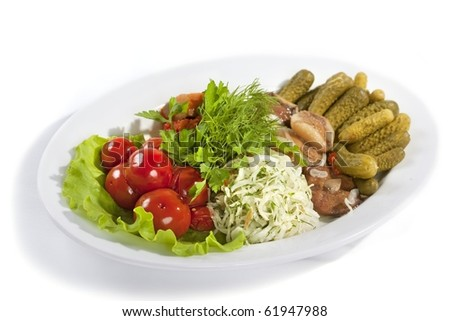 Marinated vegetables and mushrooms at the plate isolated on a white background - stock photo