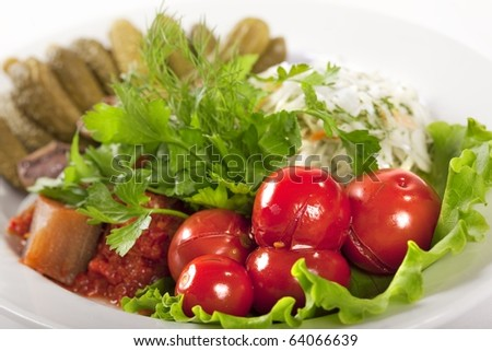 Marinated vegetables at the plate isolated on a white background - stock photo