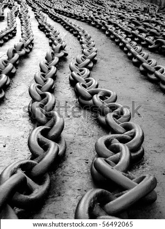 Marine anchor chain on the floor after painting... - stock photo
