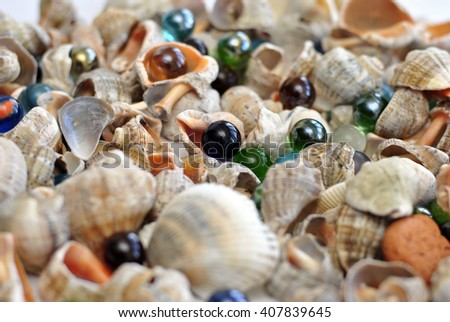 Marine background made of shells and glass colored balls - stock photo