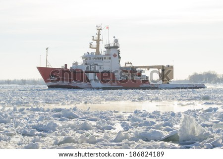 MARINE CITY, MI - USA - JANUARY 23, 2014 - The CCGS SAMUEL RISLEY on January 23, 2014 working the ice jammed St Clair River at Marine City, MI. The RISLEY is a 228' Great Lakes Canadian ice breaker.
