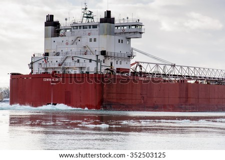 MARINE CITY, MI, USA / JANUARY 16, 2015: The EDWIN H GOTT is down bound on the St Clair River with a bow full of ice at Marine City, MI on January 16, 2015. The GOTT sails the Great Lakes.