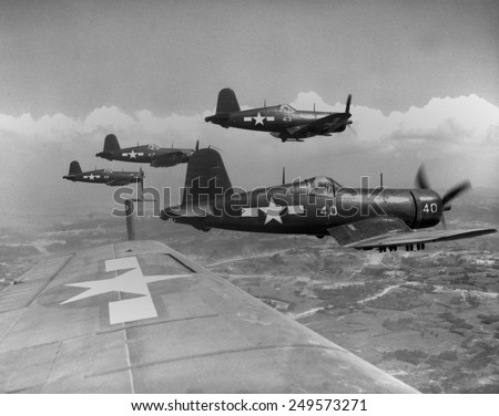 Marine Corsairs fly on a rocket strike against Japanese positions on southern Okinawa. June 10, 1945. - stock photo
