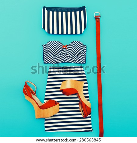 Marine Fashion style. Set clothes lady on blue background. Stylish Accessories & Shoes - stock photo