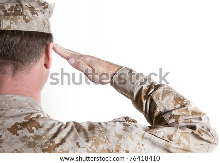 Marine In Desert Fatigues Saluting - stock photo