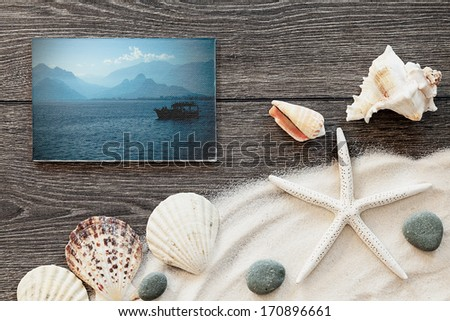 marine items on a wooden boards against sandy background, blank sea  cards - stock photo