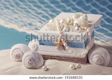 Marine life decoration on sand - stock photo