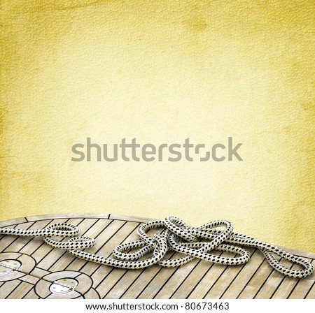 Marine rope for mooring yachts on the old textured paper background.  Ropes on the wooden deck - nautical background. Vintage design with elements of boating.