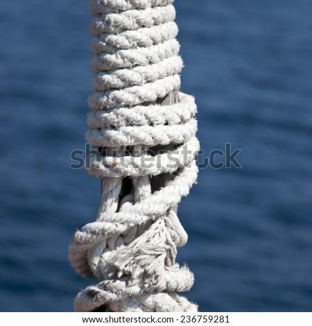 marine rope on the mast - stock photo