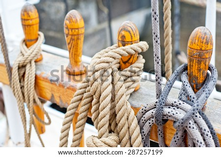 Marine ropes and tackles on the tall ship - stock photo