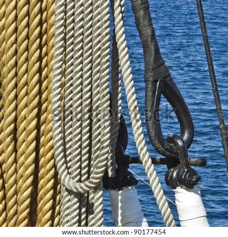 Marine ropes, rigs and mast tackle at the old nautical vessel. Tackles of ancient sailboat. Ship ropes with rigging and pulley. - stock photo