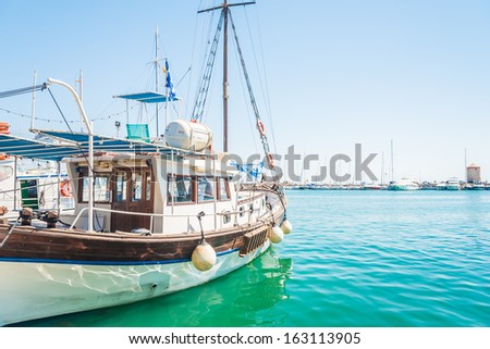 Marine ship is at anchor near the pier - stock photo
