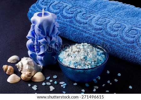 Marine Spa composition: sea salt with alga, scented candle, towel blue - stock photo