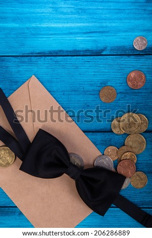 Marine theme blue background. Tie bow and money from the mail envelope - stock photo