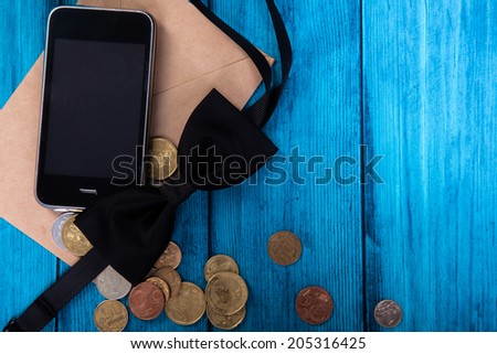 Marine theme blue background. Trendy gadget and money from the mail envelope - stock photo