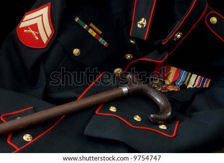Marine uniform with medals and cane - stock photo