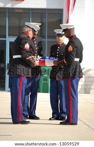 Marines folding American flag at Memorial Day ceremony