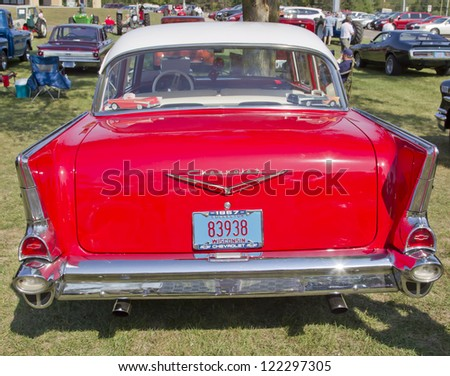 MARION, WI - SEPTEMBER 16: Back of 1957 Red Chevy Bel Air car at the 3rd Annual Not Just Another Car Show on September 16, 2012 in Marion, Wisconsin. - stock photo