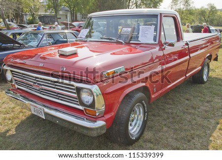 MARION, WI - SEPTEMBER 16: Front of 1969 Ford F100 Ranger Truck at the 3rd Annual Not Just Another Car Show on September 16, 2012 in Marion, Wisconsin. - stock photo